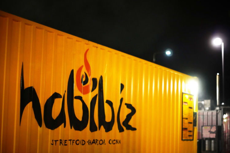 Habibiz collection of container restaurants in Canberra with great graffiti art Architectural Detail Architecture Canberra Canberra City Canberraart Canberraatnight Canberralife Container Design Food Graffiti Graffiti Art Hipster Illuminated No People Outdoor Eating Outdoors Restaurant Decor Yellow