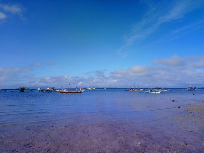 blue & blue Sea Water Sky Beach Scenics - Nature Blue Tranquility No People Boats Cloud - Sky Outdoors
