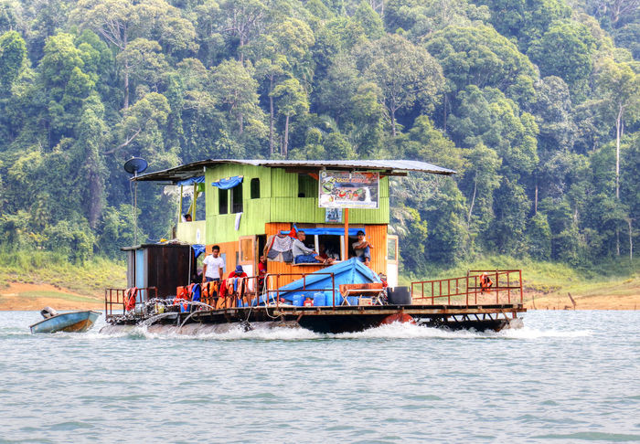 Kenyir Lake is the largest man-made lake in South-East Asia. Covering an area of 260,000 hectares, it is home to some 300 species of freshwater fishes Boat Boathouse Kenyir Kenyir Lake Malaysia Terengganu Tropical Jungle Tropical Paradise Water