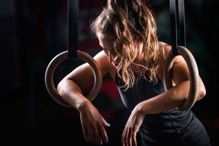 Athlete Leaning On Exercise Equipment At Gym