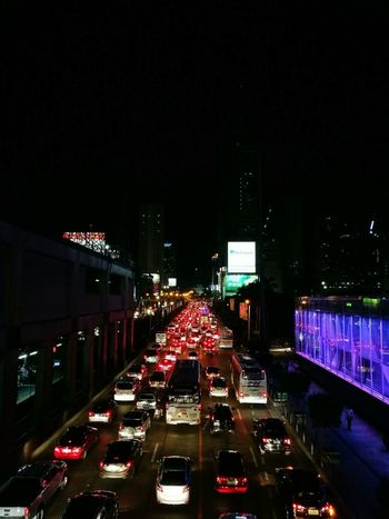 Car Night Traffic Illuminated Land Vehicle Transportation City Mode Of Transport City Life City Street Traffic Jam Outdoors Road Rush Hour Building Exterior Architecture Cityscape No People