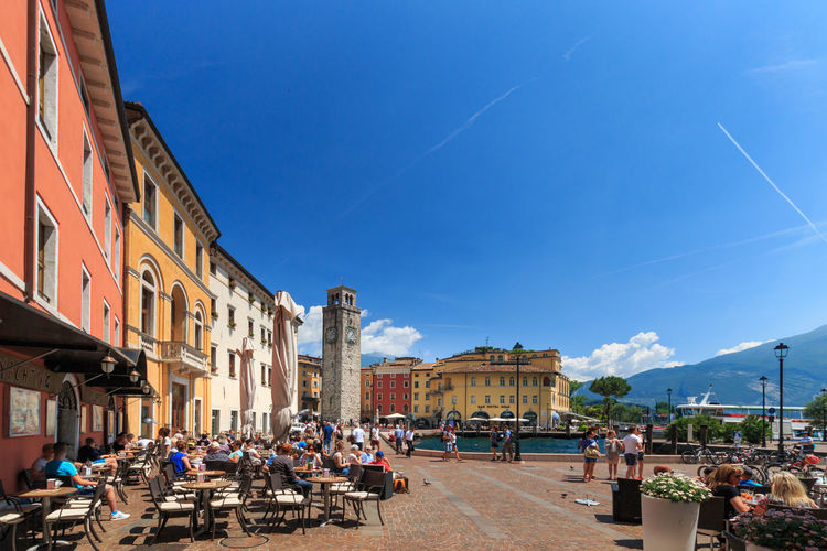Riva del garda, italy, may 25, 2017. old town and piazza iii novembre against blue sky