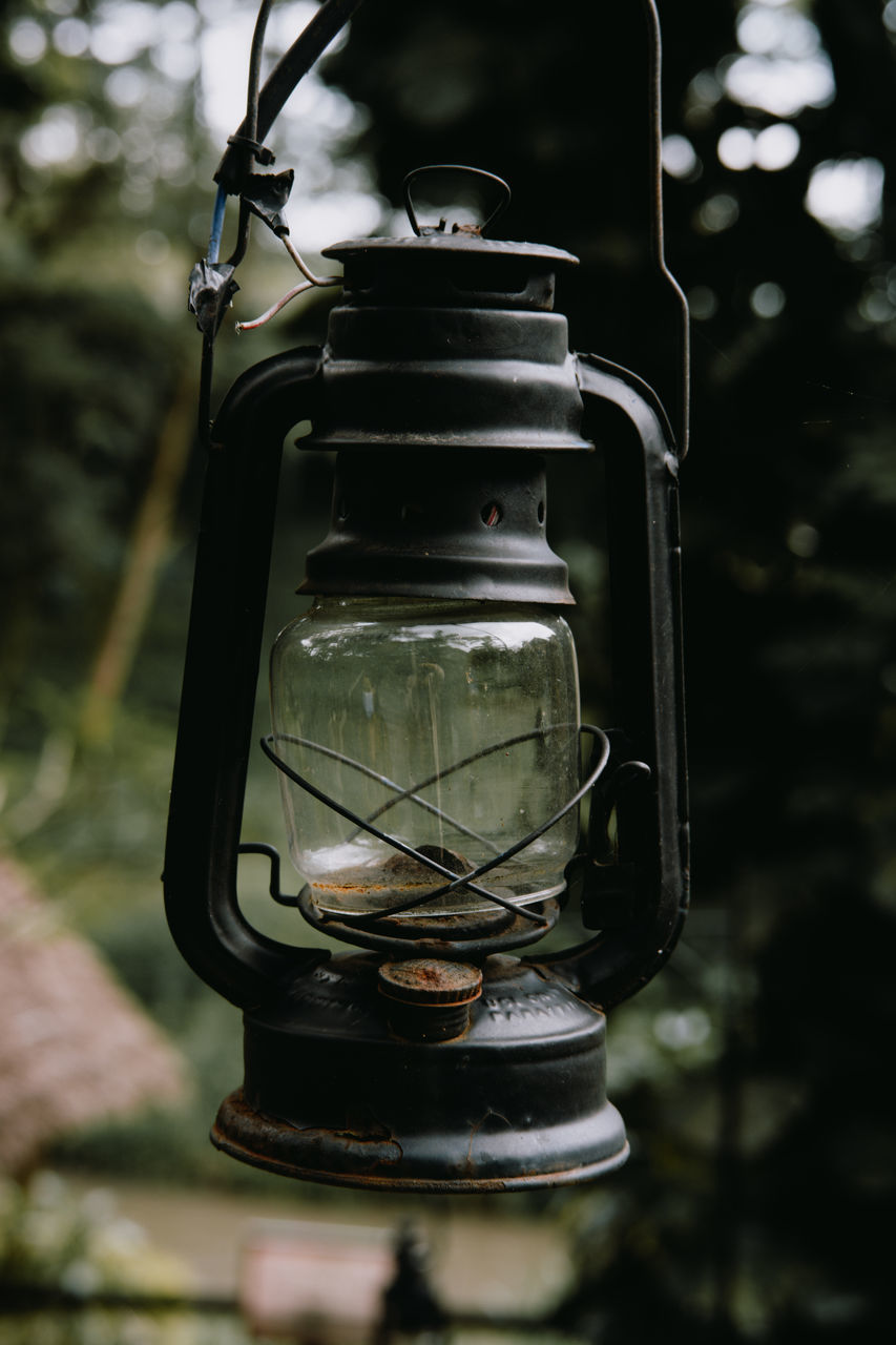 CLOSE-UP OF ELECTRIC LAMP HANGING IN METAL