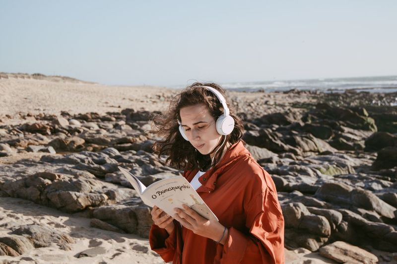 Reading and listening to music on beach Headphones Music Adult Adults Only Beach Beautiful Woman Book Day Holding Nature One Person One Woman Only One Young Woman Only Only Women Outdoors People Sea Sky Standing Young Adult Young Women Been There. Done That. The Week On EyeEm