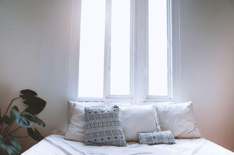 Furniture Bed Window Pillow Indoors  Bedroom Home Interior Domestic Room White Color Day Curtain Absence No People Cushion Comfortable Relaxation Textile Chair Stuffed Cozy