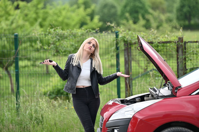 Woman standing in a car