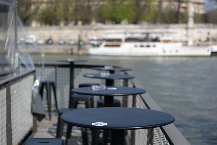 Tables in a row at harbor