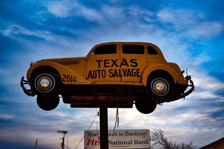 Antique car used as a sign for a defunct auto salvage yard. Americana Antique Car Clouds And Sky Focus On Foreground MeinAutomoment Roadsidephotography Texas Unusual Signs