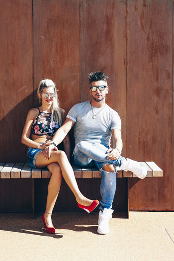 Sitting Full Length Two People Real People Young Adult Togetherness Casual Clothing Portrait Young Women Looking At Camera Front View Leisure Activity Young Men People Lifestyles Glasses Women Smiling Bonding Couple - Relationship Beautiful Woman