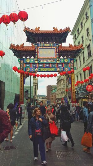 Architecture Built Structure People Travel Destinations Red Adult Day Building Exterior Outdoors Men Large Group Of People Women Real People London Your Ticket To Europe City Lifestyles Chinatown Hanging Taking Photos Adults Only City Sky