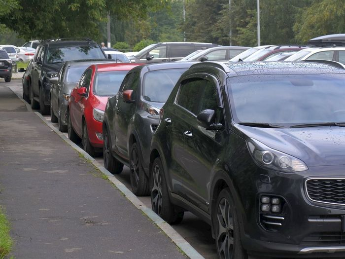 Cars parked on road in city