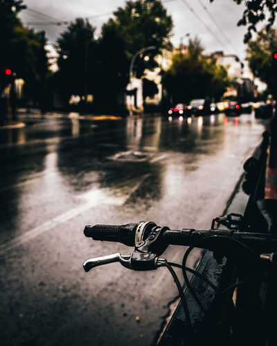 Bicycle on wet road in city during rainy season