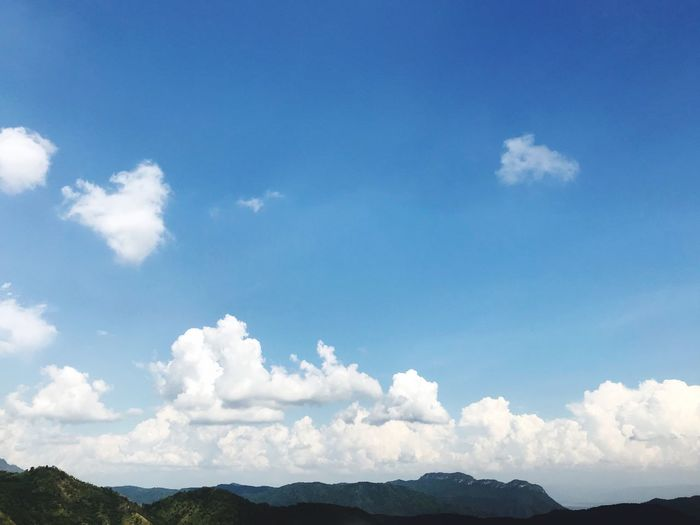 Low angle view of mountains against blue sky