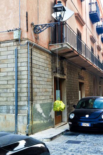Car on street against building