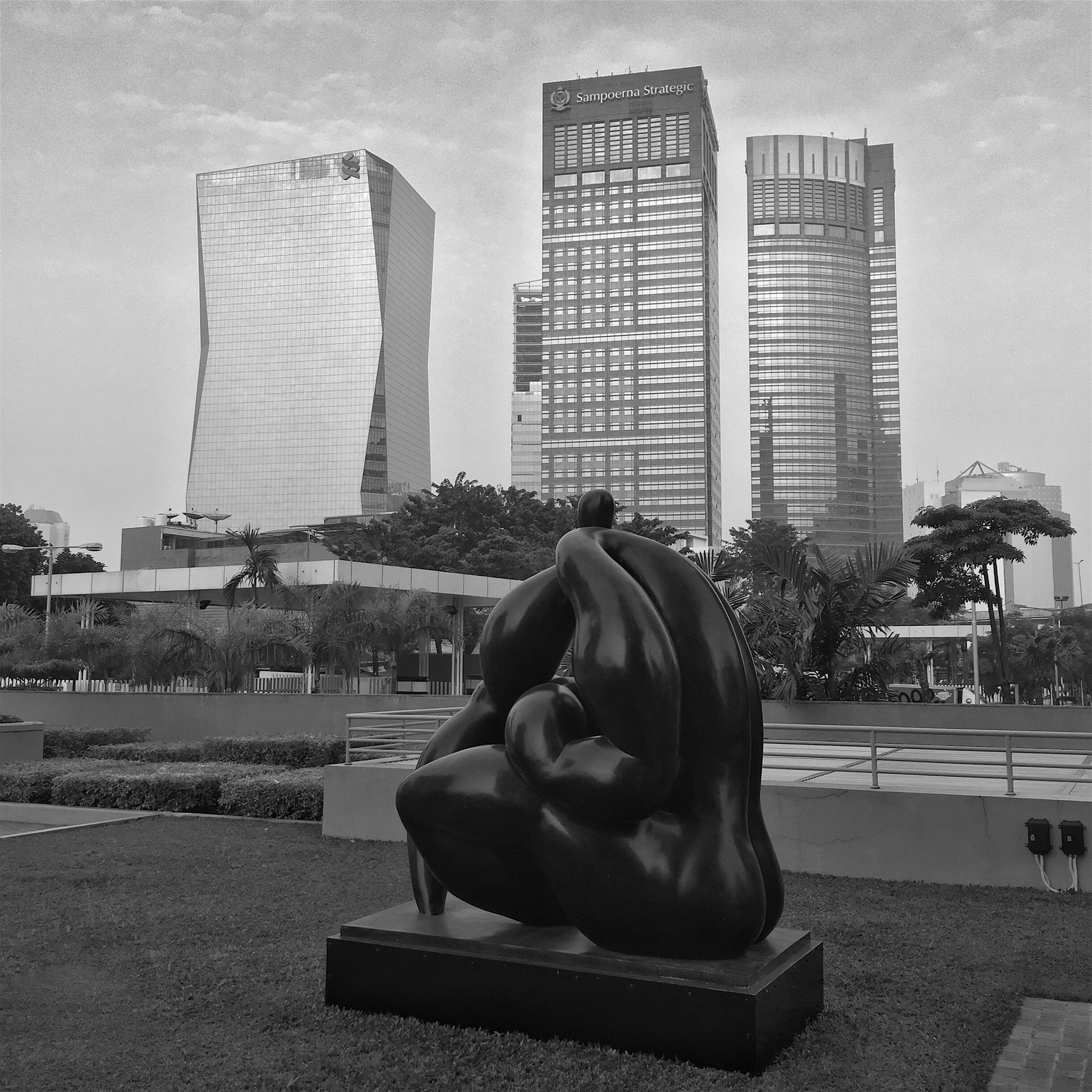 building exterior, architecture, city, built structure, skyscraper, rear view, sitting, sculpture, statue, men, full length, city life, day, modern, relaxation, office building, lifestyles, leisure activity