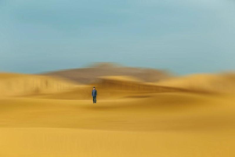 Man standing at desert