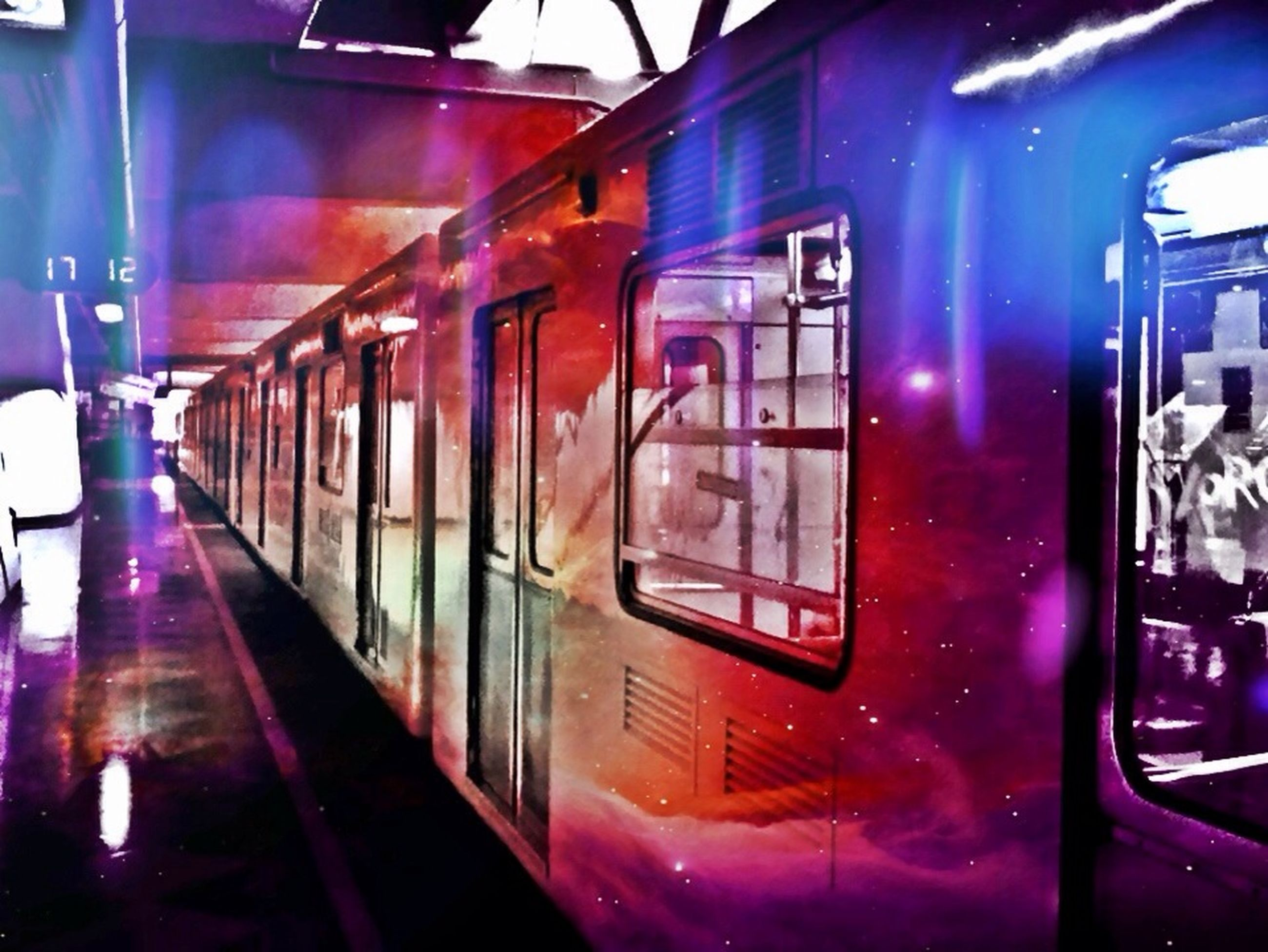 transportation, mode of transport, public transportation, train - vehicle, land vehicle, travel, railroad station platform, rail transportation, passenger train, railroad station, railroad track, illuminated, indoors, car, glass - material, vehicle interior, on the move, incidental people, transparent, train