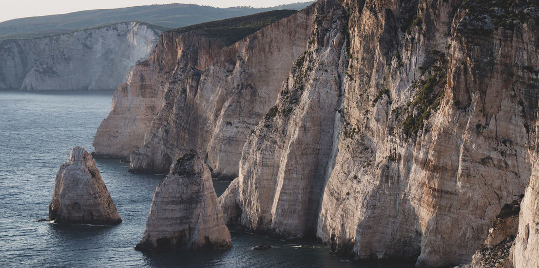 Panoramic view of rock formations in sea