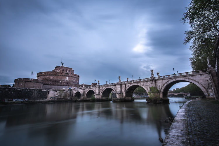 Rome Italy Rome Roma Copyspace Copy Space Long Exposure Castle Arched Outdoors Reflection No People Waterfront The Past History Travel Destinations Arch Bridge Nature River Building Exterior Arch Cloud - Sky Bridge - Man Made Structure Connection Bridge Sky Water Architecture Built Structure