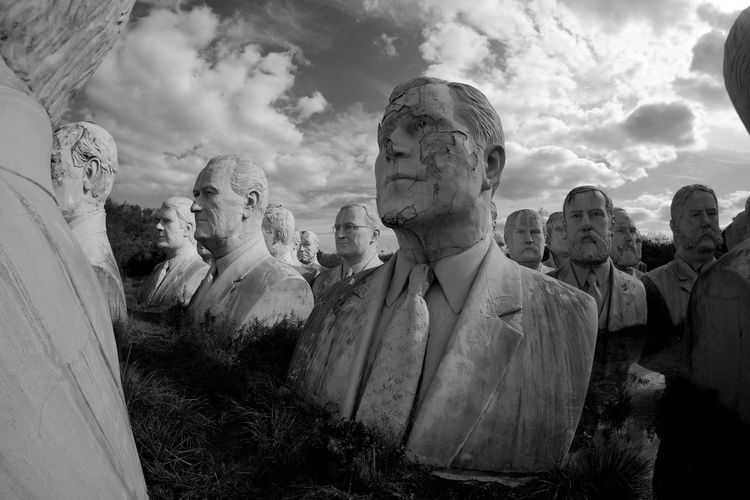 Low angle view of statues against sky