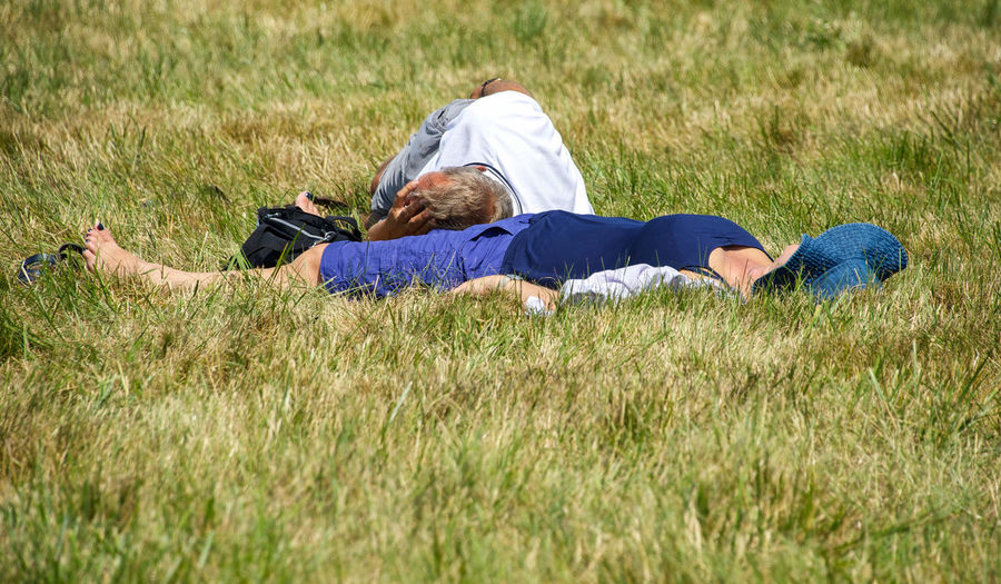 Just a Little Nap! Couple Hat Love Napping Peace Adult Blue Clothes Day Full Length Grass Lying Down Lying On Back Nap Naptime Nature Outdoors People Relaxation Residential Building Resting Resting Time Sleep Sleeping Two People