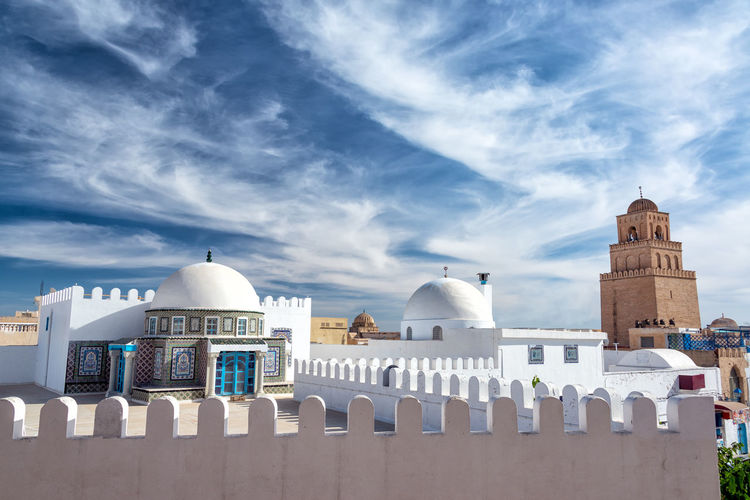 Dramatic looking sky with the Great Mosque in the background in Kairouan, Tunisia City Famous Medina Ramadan  Tunis Tunisia Africa Architecture Building Culture Destination Dome Great Islam Kairouan Landmark Minaret Mosque Muslim Religion Temple Tourism Tower Traditional Travel