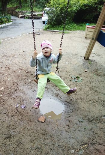 There is no bad weather! Girl Child Childhood Swing Yard Ride On A Swing Slush Wet Wet Ground Cloudy Happy