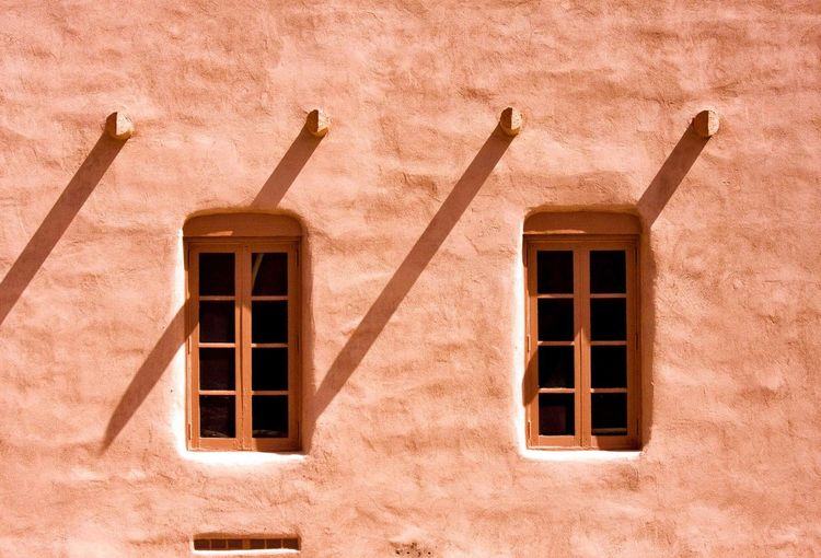 Windows in the Adobe Wall Windows Adobe Building Building Exterior Built Structure Architecture Window No People Building Sunlight Day Low Angle View Outdoors Shadow Wall - Building Feature Nature Safety Protection Geometric Shape Shape Sunny
