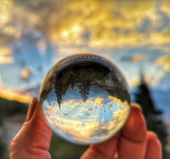 Human Hand Planet Earth Water City Holding Magnifying Glass Reflection Close-up