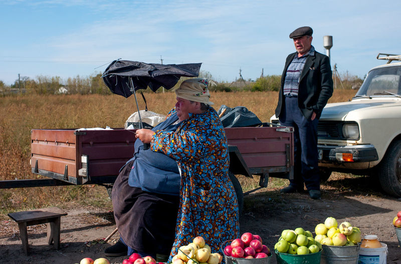 People with fruits at farm