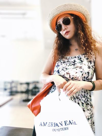 Portrait of woman wearing sunglasses standing outdoors