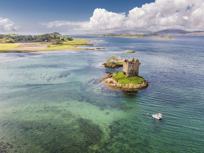 Aerial of the historic castle Stalker in Argyll, Scotland Castle Coastline Loch  Scotland Travel United Kingdom Argyll Beauty In Nature Destination Highlands Highlands Of Scotland Historic Landmark Linnhe Medieval Outdoors Scenics Shore Stalker Tranquility Uk Water Waterfront First Eyeem Photo