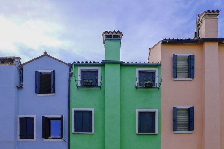 Architecture Building Exterior Built Structure Cloud - Sky Day Green Color Low Angle View No People Outdoors Residential Building Sky Window