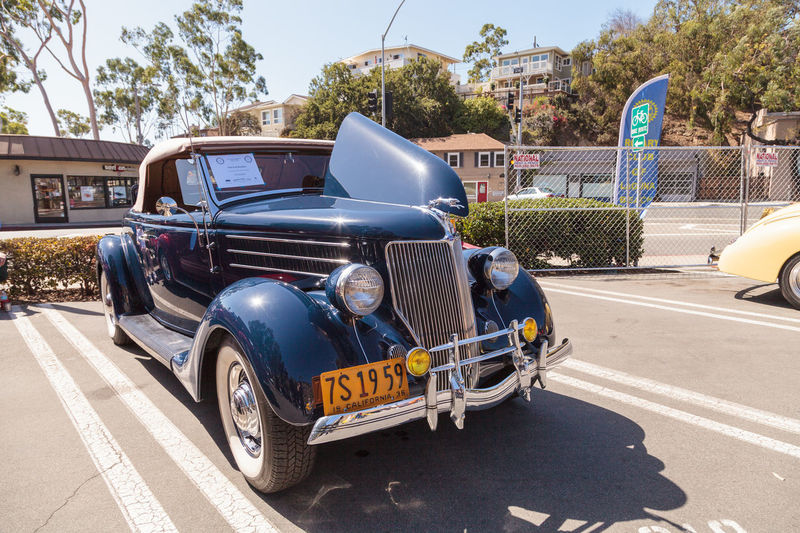 Laguna Beach, CA, USA - October 2, 2016: Navy blue 1936 Ford Roadster owned by Jim Sprinkel and displayed at the Rotary Club of Laguna Beach 2016 Classic Car Show. Editorial use. 1936 Automobile Car Car Show Classic Car Classic Car Show Ford Ford Roadster Laguna Beach Old Car Vintage Car