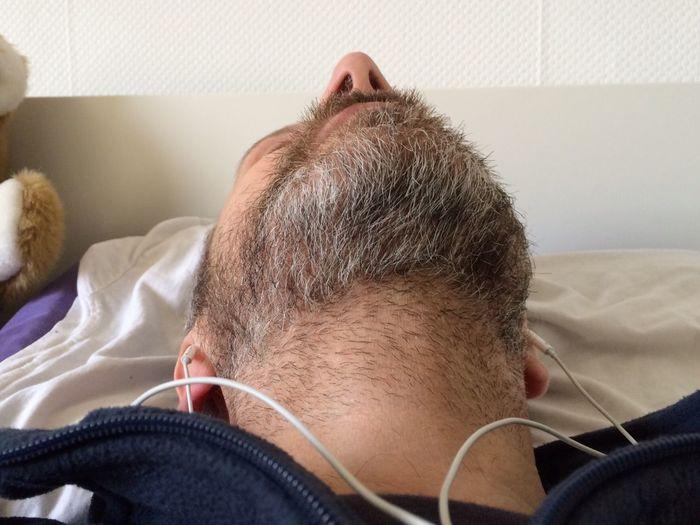 Man With In-Ear Headphones