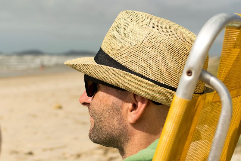 EyeEm Selects Outdoors Real People Hat Focus On Foreground One Person Beach Sand Day Headshot Nature Close-up Sky Sun Hat