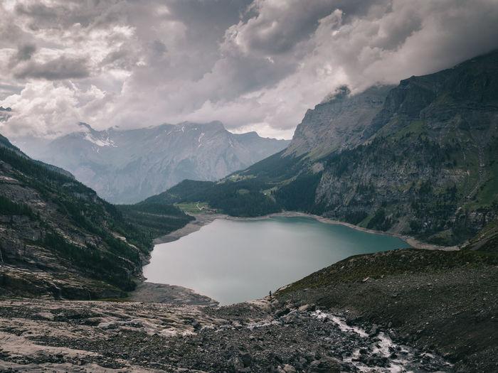 Oeschinensee Kandersteg Mountain Beauty In Nature Scenics - Nature Water Cloud - Sky Sky Tranquil Scene Tranquility Nature Mountain Range Environment No People Landscape Non-urban Scene Idyllic Lake Day Remote Outdoors Mountain Peak