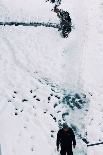 High angle view of man on snow covered landscape