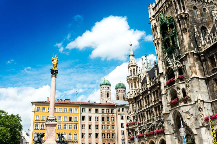 Low Angle View Of Virgin Mary Statue On Column At Marienplatz