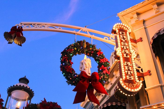 Vacation Magic Disney Decorations Christmas Low Angle View Amusement Park Arts Culture And Entertainment Built Structure Hanging Architecture No People Outdoors Clear Sky Carousel Blue Amusement Park Ride Day Sky