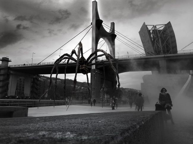 Blackandwhite Spider Gugenhain Museum Bilbao Real People Cloud - Sky Sky Men Built Structure Leisure Activity Water Day Architecture California Dreamin Stories From The City