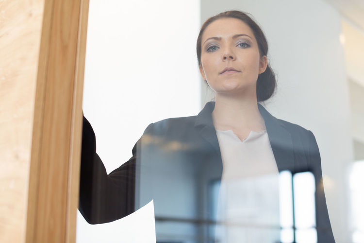 Young businesswoman in the office At Work Beauty Business Businesswoman Career Desk Indoors  Office People Portrait Portrait Of A Woman Single Person Success Women Working