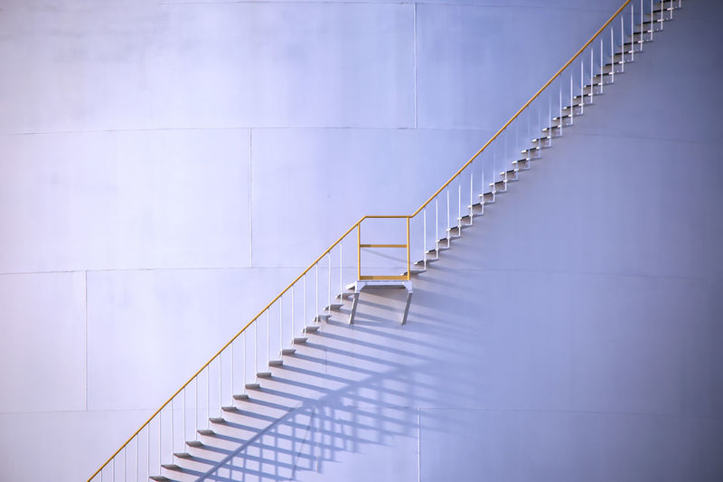 Low angle view of staircase against white wall