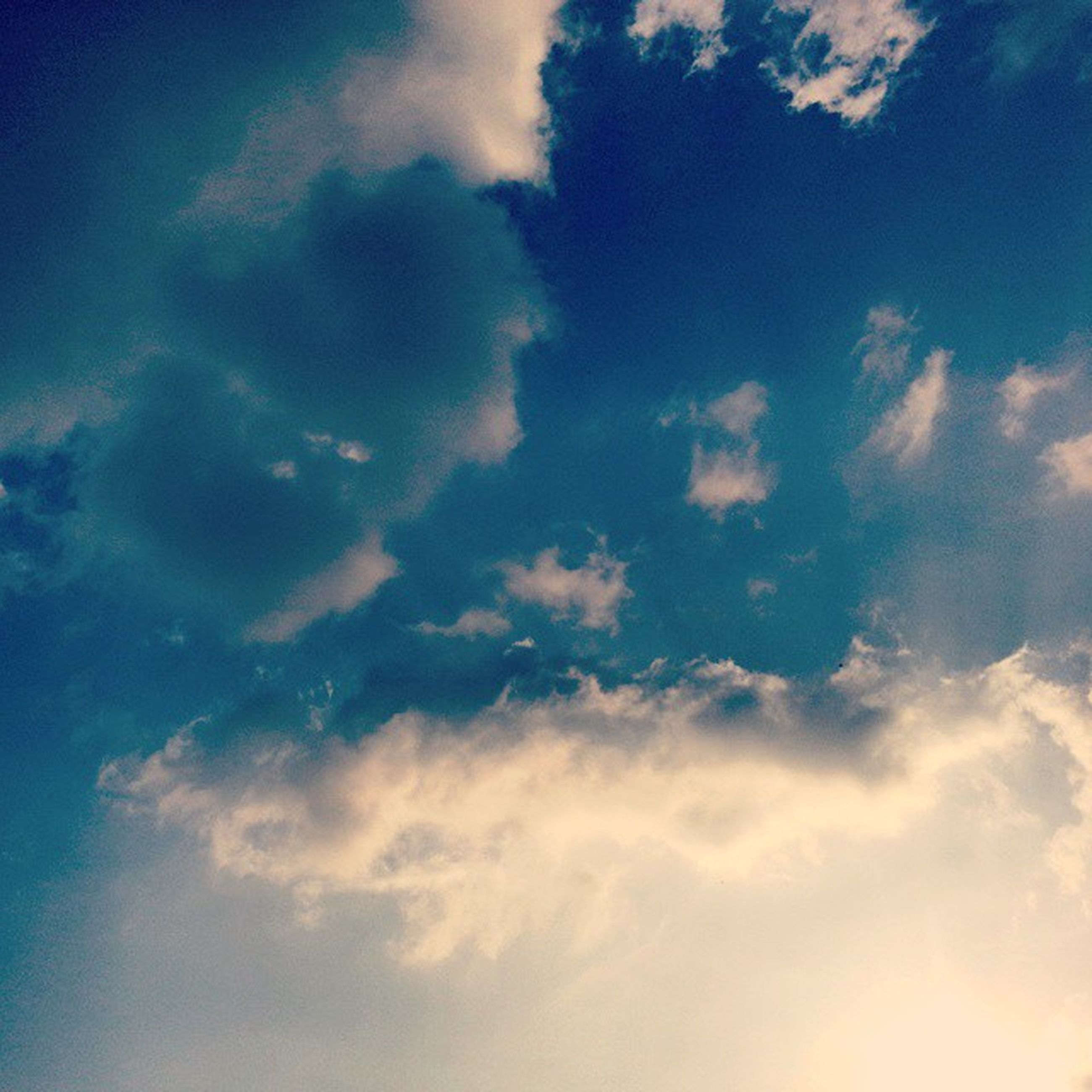 sky, low angle view, cloud - sky, blue, sky only, beauty in nature, tranquility, scenics, nature, tranquil scene, cloud, cloudy, cloudscape, backgrounds, idyllic, outdoors, full frame, no people, majestic, day