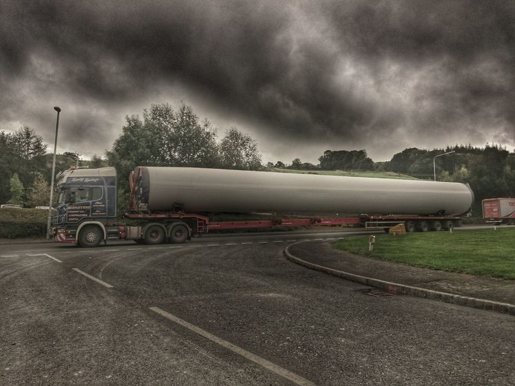 Transportation Land Vehicle Mode Of Transport Cloud - Sky Overcast Cloudy Moody Sky Transportation Vehicle Wind Turbine It Is Wind Turbine Turbine Parts Long Vehicle Parts Of Things Transpotation Large Moving The Way Forward Transportation Heavy Equipment Sony Xperia Z3 Wales Architecture No People