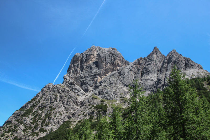 Beauty In Nature Blue Clear Sky Contrail Day Dolomites High Karlsbaderhütte Low Angle View Mountain Mountain Range Nature No People Osttirol Outdoors Rock - Object Scenics Sky Tranquil Scene Tranquility Vapor Trail
