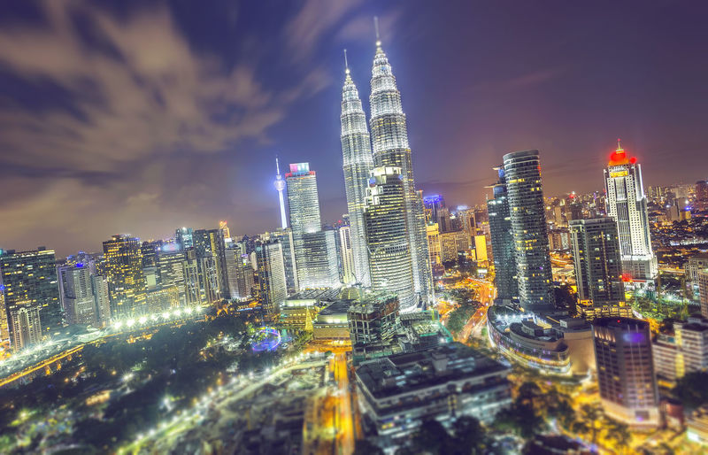 Cityscape image of Kuala Lumpur, Malaysia during sunset. ASIA KLCC Twin Towers Kuala Lumpur Modern Architecture Travel Architecture Building Exterior Built Structure City Cityscape Downtown District Illuminated Malaysia Modern Night No People Outdoors Petronas Twin Towers Sky Skyscraper Tall - High Tower Travel Destinations Urban Skyline Vacation