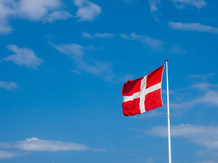 Danish Flag Dannebrog Dänemark Denmark Danebrog Dannebrog Danish Flag Flag Patriotism Sky Cloud - Sky Low Angle View Red Nature Blue No People Wind Striped Independence National Icon
