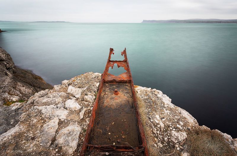 Abandoned pier by sea