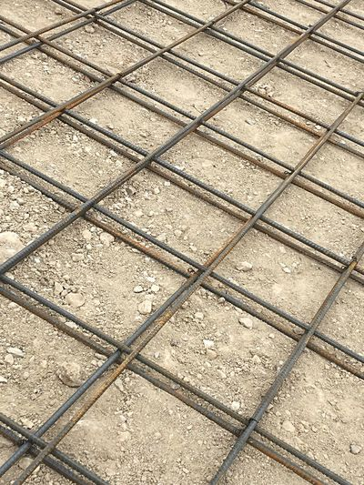 Concrete Life Rebar Steele Tying Steele Concrete Cement Pad Work Pour Dirt Life Blue Collar Build Pattern Slab Full Frame Backgrounds No People Outdoors Textured  Day Close-up Gravel